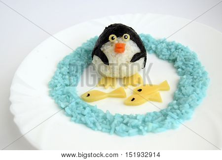 The penguin is made of rice. Ridiculous food for good mood and appetite