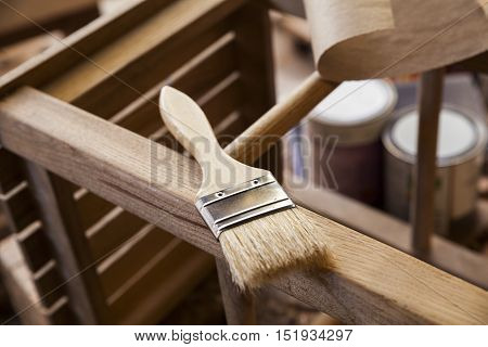 closeup of paint brush and varnish can