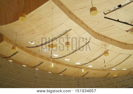 MOSCOW - APR 20, 2015: Big lowered ceiling with wooden decoration and lights in Svetlanov hall, House of Music