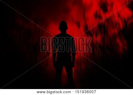 Silhouette of man walk in the woods