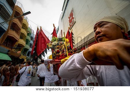 Hatyai, Songkhla, Thailand - Oct. 7, 2016 :  People celebrate a vegetarian festival during the festival ritual mortification is practised to appease the Gods.Action photography Capturing movement.