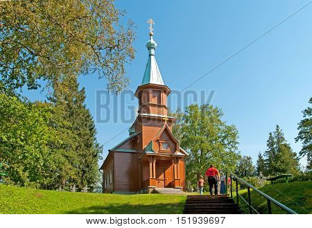 KUREMAE, IDA-VIRUMAA COUNTY, ESTONIA - AUGUST 21, 2016: Church of St Arsinius and St Nicholas on the monastery cemetery. Puhtitsa Dormition Convent. The Estonian Orthodox Church of Moscow Patriarchate