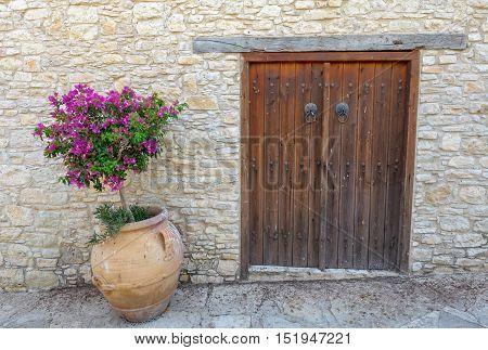 Old wooden door in the brick wall