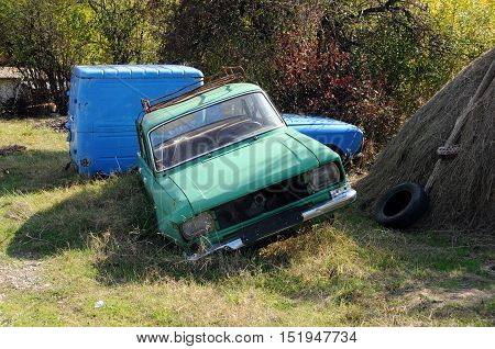 Abandoned old Russian-made cars in the rural area
