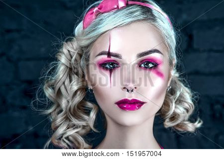 Beautiful Blonde Girl With Two Pigtails, With Creative Doll Make-up: Pink Glossy Lips, Wearing Pink