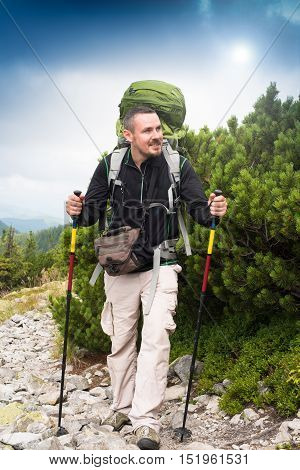 Hiker. Happy hiker. Hiker mountain. Hike.Hiking. Concept success. Hiker sunset. Hiker smiling. Tired tourist. Tired hiker. Concept freedom. Concept inspiration. Winning life goal. Healthy lifestyle.