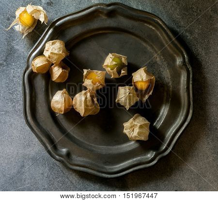 ground cherries or tomatillos on an old pewter plate