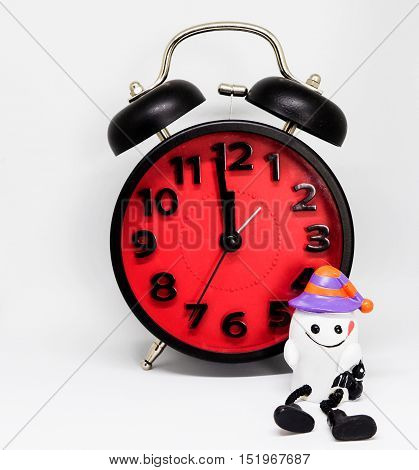 Halloween count down clock with a white ghost toy.