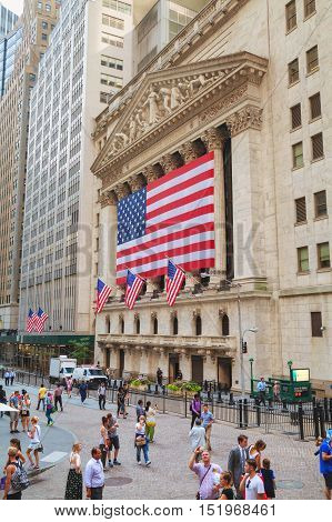 NEW YORK CITY - September 3: New York Stock Exchange building with people on September 3 2015 in New York. The NYSE trading floor is located at 11 Wall Street and is composed of 4 rooms used for facilitation of trading.