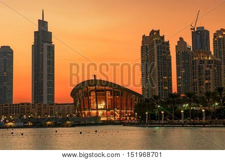 DUBAI, UAE - OCTOBER 13, 2016:  A sunset night shot of the iconic dhow-shaped building of Dubai Opera is a masterpiece of contemporary design, and opened on 31st August 2016