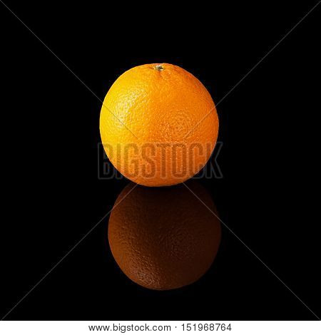 Orange isolated on a black glossy background with realistic reflection