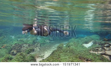 Snorkel in the river of crystalline water