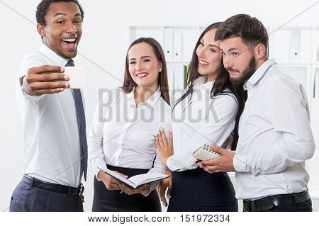 Four Businesspeople Taking A Selfie