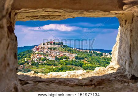 Town of Motovun on pictoresque hill of Istria through stone window Croatia