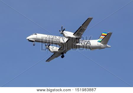 Stockholm, Sweden - May 3, 2016: Braathens Regional (SE-LSF) Saab 2000 aircraft during approach to Bromma airport against blue sky.