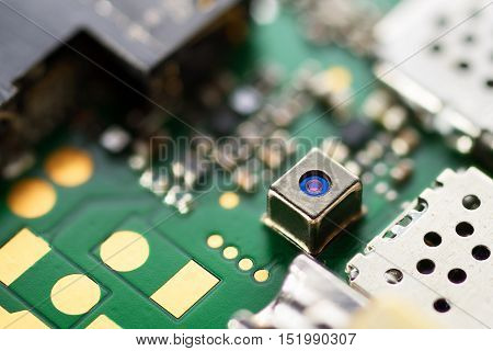 Mobile SMD camera on electronic circuit board. Macro shot