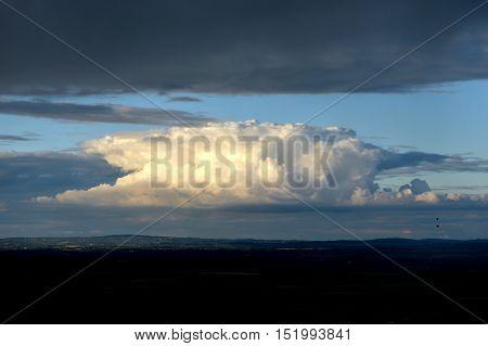Cumulonimbus anvil shaped storm cloud over countryside