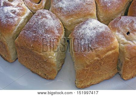 typical austrian crumpet called buchteln strewn with icing sugar