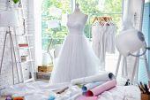 Made-up wedding dress on mannequin in wedding designer studio poster