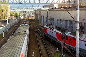Electric locomotive pulling high-speed train on rails. Technical railway station - operational locomotive depot. Transport infrastructure of Russian Railways Saint-Petersburg poster