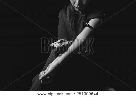 Drug Addict Woman Use Syringe Injecting Drugs In Her Arm. Drugs Addict Concept