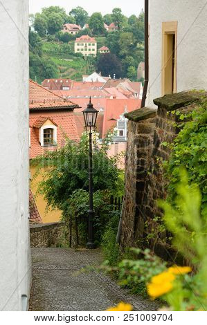 Houses In Old Narrow Street With Cobble Stones In Meissen, Germany