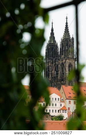 Cathedral In Meissen, Germany Seen From A Narrow Historical Street