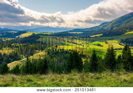 Lovely Rural Area In Mountains. Huge Cloud Formation Over The Distant Ridge. Picturesque Scenery Of