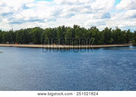 The Dnieper River And The Panorama Of The City Of Kiev. Rest On The River. Fishing. Green Islands In