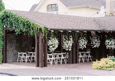 The Cozy Place For A Wedding Ceremony In A Summer Arbor. The Place For A Wedding Ceremony