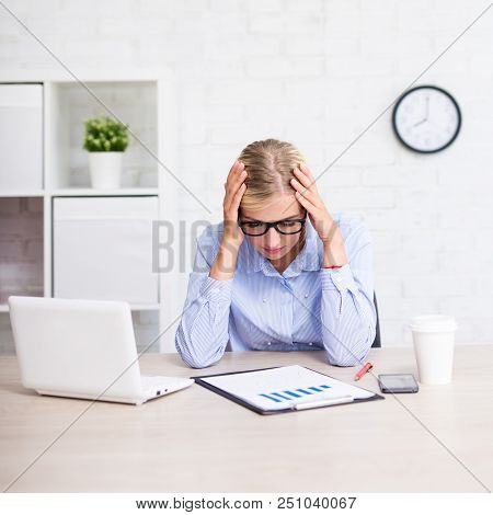 Stressed Business Woman Sitting In Modern Office