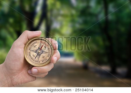 Male Hand Holding Success Compass
