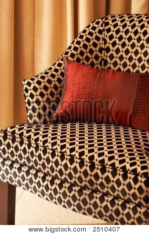Colorful Cushions On The Chair