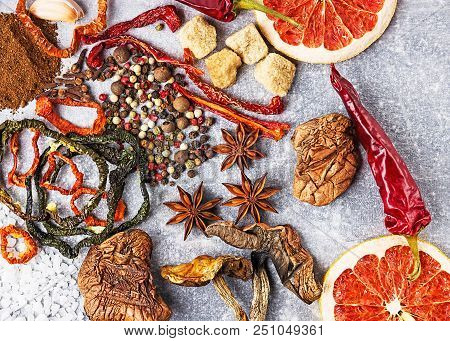 Spices On The Stone Black Background. Condiments On A Dark Table. Seasoning For Cooking. Seasoning M