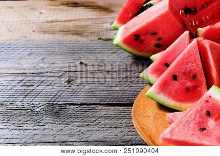 Fresh Sliced Watermelon On Wooden Background With Copyspace