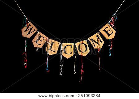 Welcome Party Banner. Bunting Letters Spelling The Word Welcome With Celebration Streamers Isolated