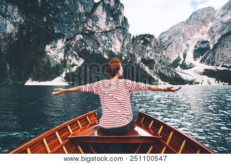 Tourist Woman In Traditional Wooden Rowing Boat On Italian Alpine Braies Lake. Girl Enjoying Stunnin