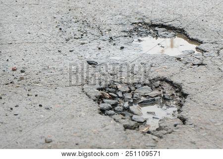 Potholes. Potholes Dangerous To Motorists And Pedestrians.