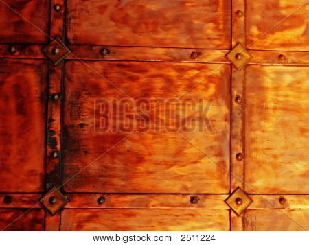 coppery metal wall texture with rivets background poster