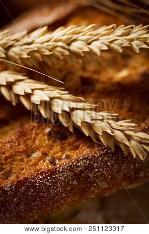 Close-up View Of Bread With Ears Of Wheat