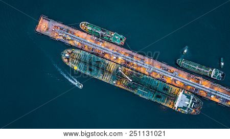Aerial View Of Oil Tanker Ship At The Port, Aerial View Oil Terminal Is Industrial Facility For Stor