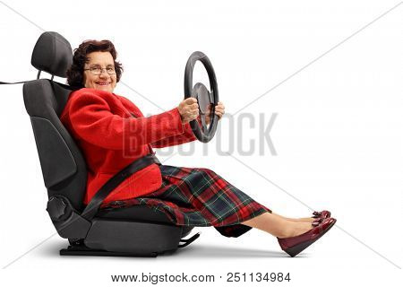 Senior lady sitting in a car seat and driving isolated on white background