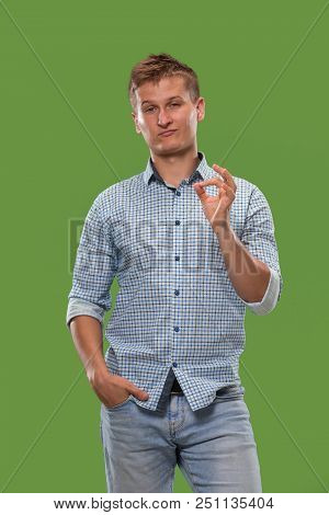 I Am Ok. Happy Businessman, Sign Ok, Smiling, Isolated On Trendy Green Studio Background. Beautiful