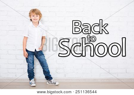Back To School - Portrait Of Little School Boy In Glasses Over White Brick Wall