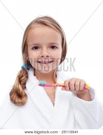 Little girl washing teeth after bath - personal hygiene education