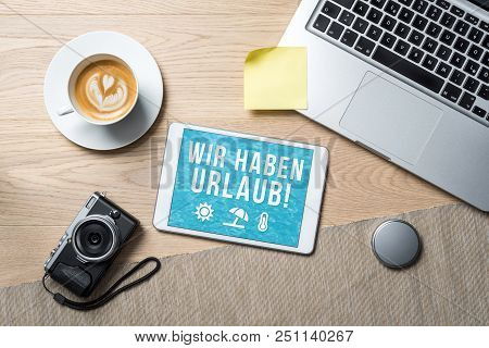 Wir Haben Urlaub Written In German On Tablet Meaning Company Holiday As Flatlay From Above Of An Off