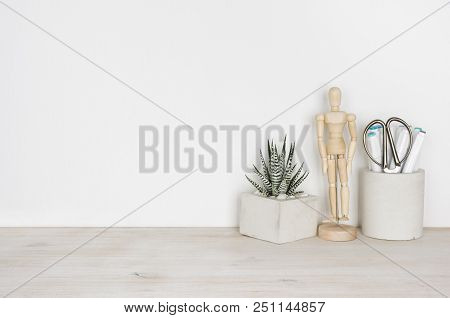 Wooden Desktop With Flower Pot, Human Statuette And Office Supplies