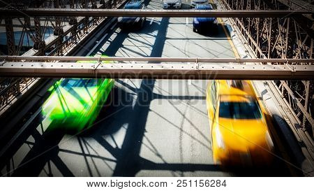 Looking Down On Traffic On A Bridge In New York City.