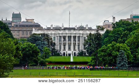 The Usual Crowd Of Tourists Taking Photos Of The White House At The South Lawn.