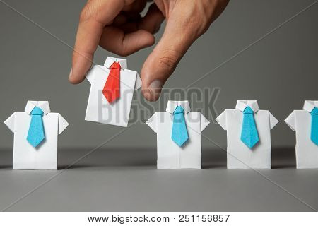 Choosing Good Employee Leader. Man Chooses And Takes In The Hand An Employee In Shirt And Red Tie. S